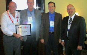 Managing partners of RepWorks Marketing accept Auto 7's 2014 Manufacturer Representative of the Year commemorative plaque at AAPEX on November 5. From left: Jim Murphey, Auto 7 senior vice president, Randy Pack, RepWorks owner and managing partner, Phil Rogovoy, RepWorks managing partner, and Steven Kruss, Auto 7 president.
