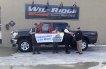 From left to right: Scott Klinesmith, Wil-Ridge technician; Roel Tejeda, Wil-Ridge technician; John Lupiccolo, shop manager and winner; handing the keys over is Territory Salesman Scott Biggs.