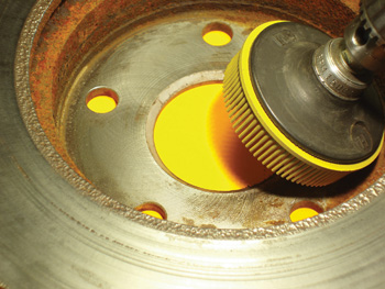 Dirt, corrosion, and distortion in the hub area of any brake rotor can cause pedal pulsation complaints.